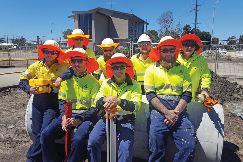 Civil Construction Trainees sitting together with their high-vis uniforms and hard hats